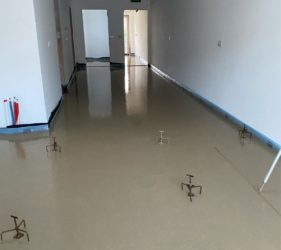 Mobile Screed Factory Sudanit 280 Self Levelling Screed_laid to laser set tripods by Fast Floor Screed Ltd